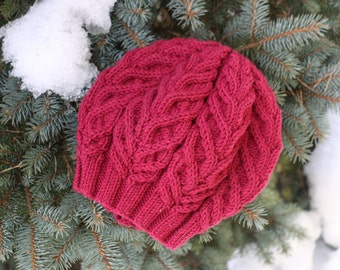 Beautiful hand knitted cable hat in size M. 100% merinowool