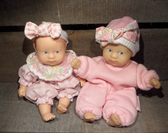2 Vintage Corolla vinyl dolls and additional clothes