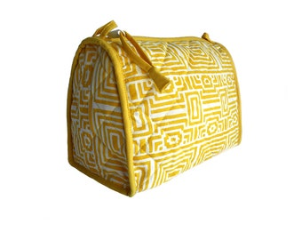 Large Yellow Geometrical Wood-Block Printed Toiletry. Comes with Interior Pockets and Plastic Lining