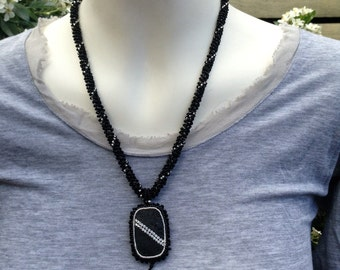 Swarovski Pendant Necklace. Black lava, silver & Crystal beaded cabochon on woven seed bead rope with ornate silver. Bead embroidery.