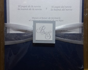 Type wedding card above in blue, silver and white