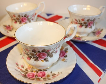 3 Tea cups and saucers pink rose design
