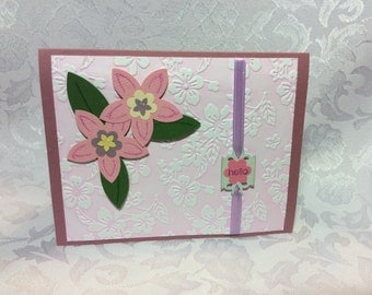 A Hello Hand Made Card with Embossed Front and Pink Flowers