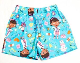 Size 3T shorts -- dark teal Doc McStuffins theme print