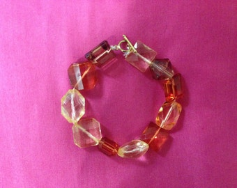 orange,brown,and yellow bracelet