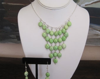 Green bib necklace with dangle earrings