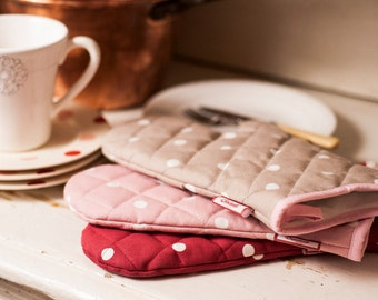 Pink dotty oven mitts