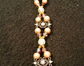 Beaded vintage inspired braclet in champagne and topaz