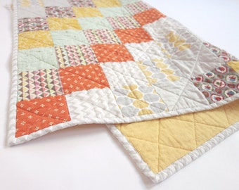Patchwork baby quilt with gold, grey and orange overtones. Gender neutral, perfect for a boy or girl.