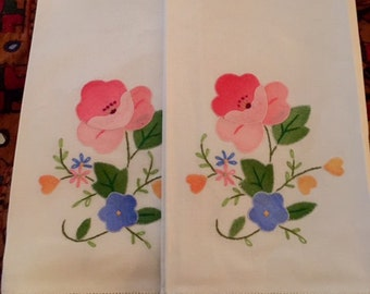 pair of vintage 1950s linen hand appliqued tea towels with contrast edging
