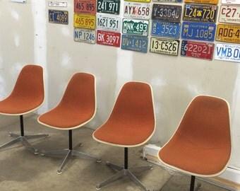 Herman Miller Eames Chairs in Red Orange