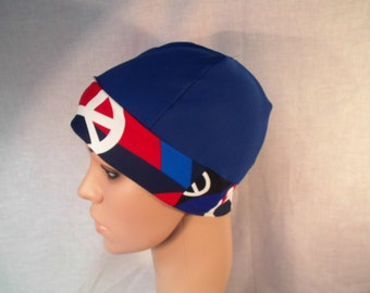 Chemo cap royal blue with peace logo.runner, chemo, head cover