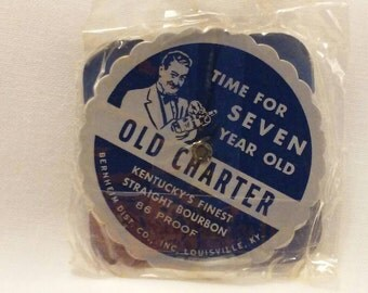 Old Charter Bourbon 1953-1980 perpetual metal pocket calendar, in original package.