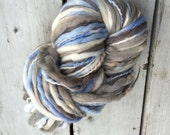 Bulky thick and thin hand dyed wool yarn. Super bulky shades of blue, white and gray like partly cloudy skies, soft yarn.