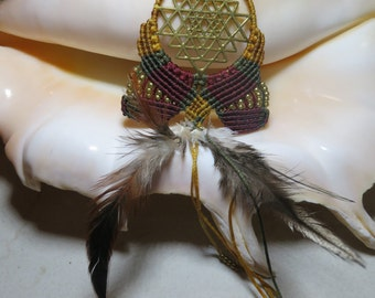 Pendant sacred geometry combined with macrame and feathers