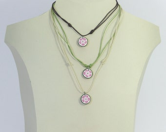 Altogether 3 single necklaces of flowers