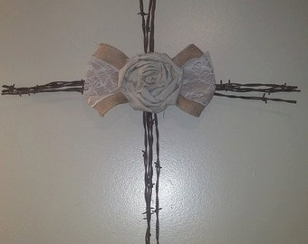 rusty barbed wire, burlap, and lace cross