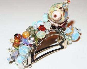 "Handbeaded Half Round Hair Clip.""Still"" was created using a variey of beads. Chubby Bird by Artisan Traci Shaffer"
