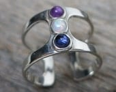 Saraesa ring ... cast sterling silver / openwork / opal, amethyst, sapphire / adjustable ring size 6