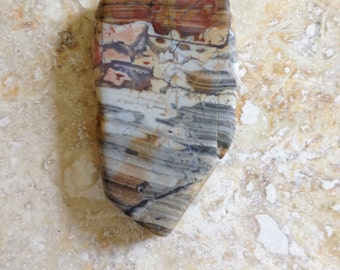 stone slab, possibly picture jasper, opaque, unpolished