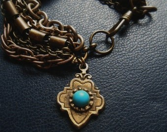 reduced- arabesque - vintage found turquoise charm talisman bracelet -