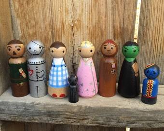 Wizard of Oz Peg People PegBuddies Doll figurines Dorothy, Glinda, Wicked Witch, Tin Man, Scarecrow, Cowardly Lion, Flying Monkey, Todo
