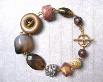 Rosetta Stone bracelet - gold plated metal and mixed burnt red, tan, brown, orange, honey, mocha stone, resin, glass bead bracelet