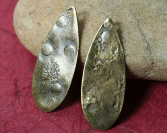 Hand hammered antique brass drop dangle pendant aprox 30x12mm (item ID YWXW01785ABK)