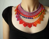 Beaded crochet lace necklace -  crocheted with cornflower blue, crimson red, orange, yellow, green glass seed beads
