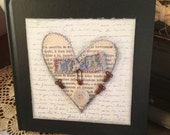 Journaling or sketching book, white pages, altered cover with paper heart and button