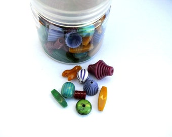 90 Vintage plastic beads beautiful colors, assorted sizes, beautiful mix in a plastic box