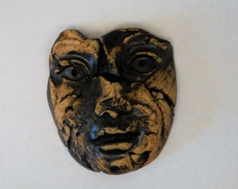 large one of a kind ceramic face...number eight