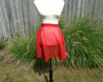 Red holiday Christmas nylon vintage half apron with green trim and one pocket