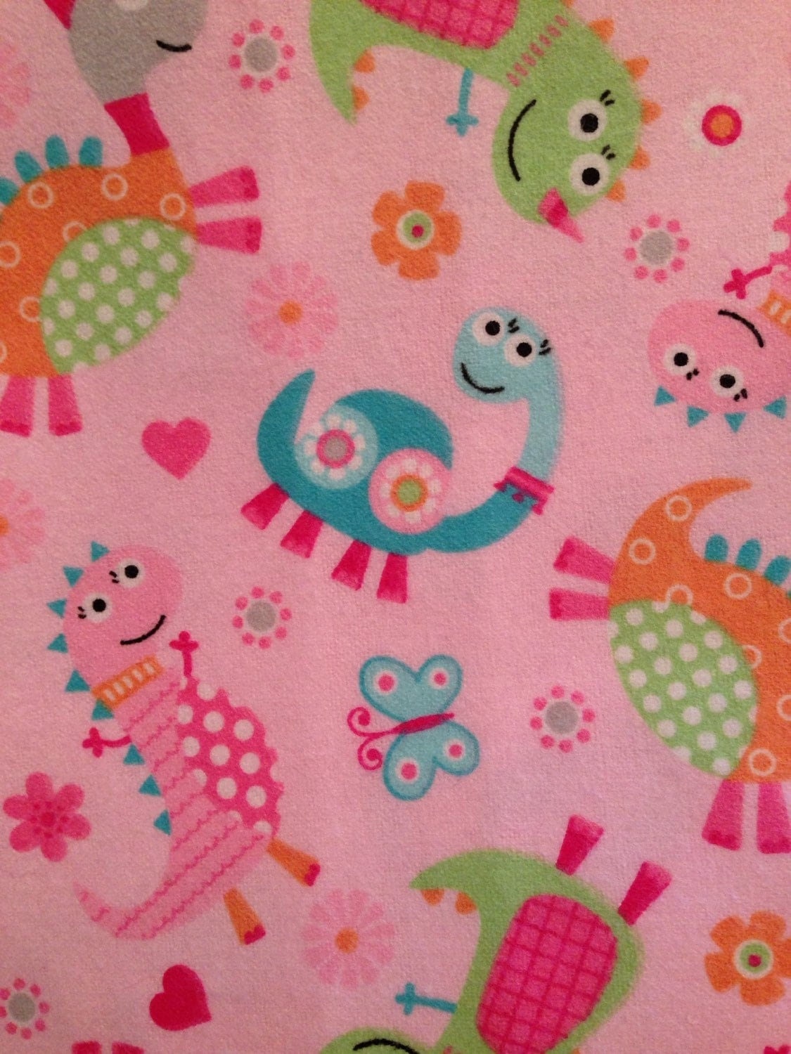 Dinosaur fabric cute pink dino toss fabric 100 percent for Dinosaur fabric