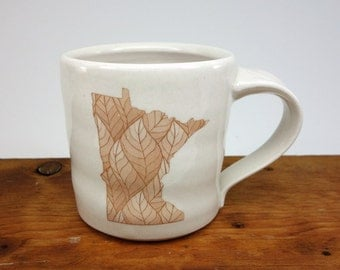 Made in Minnesota - White porcelain MN state mug with leaf pattern