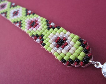 square stitch seed bead bracelet in green, red, pink and black