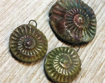 Three Raku Teal Pink Green and Gold Primitive Eternity Spirals Pendants