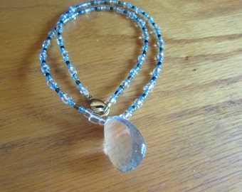 clear lodolie stone pendent