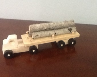 log hauler flat bed trailer tractor trailer