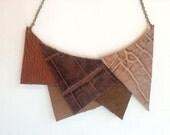 Brown geometric statement bib necklace