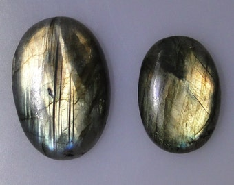 2 Labradorite oval cabs with excellent multi color flash, 70.26 carats total              043-10-634