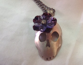 Skull cut from a silver plated spoon