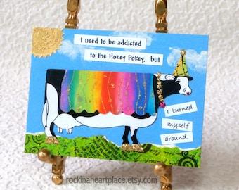 "Mixed Media ACEO - original collage art card, cow art, ""Hokey Pokey Turn Around"""