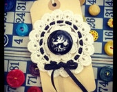 reverse curved lucite button and crochet doily brooch