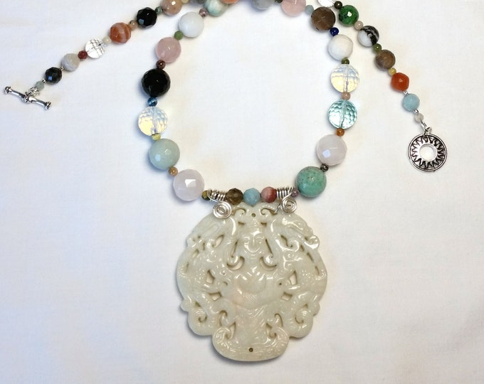 Carved White Circular Serpentine Pendant on Fancy, Faceted, Graduated Agate Bead Necklace