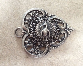 Gorgeous peacock part of a buckle or pendant