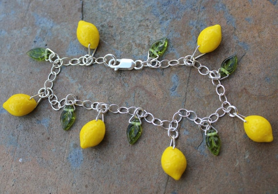 Lemon Grove Bracelet - bright yellow glass lemon beads and tiny green glass leaves on sterling silver chain