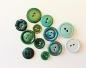 Small to Medium Green Plastic and Celluloid Buttons Including a Girl Scout Button - Vintage - Set of 12
