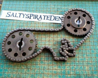 2 steel sprockets with chain, cam gears, car parts, steampunk, industrial art, metal sculpture, gas station paperweight, man cave decor