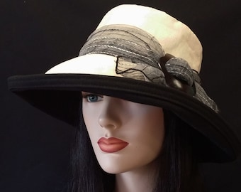 Extra Large Brim Sun Hat in Natural Cotton Linen with Wide Brim with black trim sheer neutral scarf with buckle.